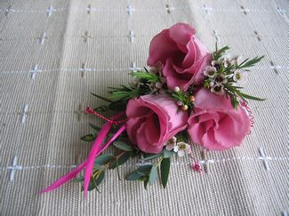 Pink Lisianthus Corsage with wax flower