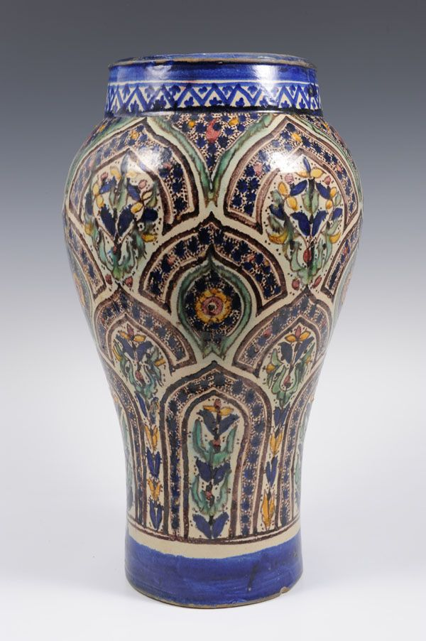 Old Islamic pottery oviform vase painted with polychrome stylised floral decoration, signed, 43cm high