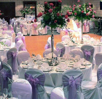 White Chair Covers With Lavender Sashes