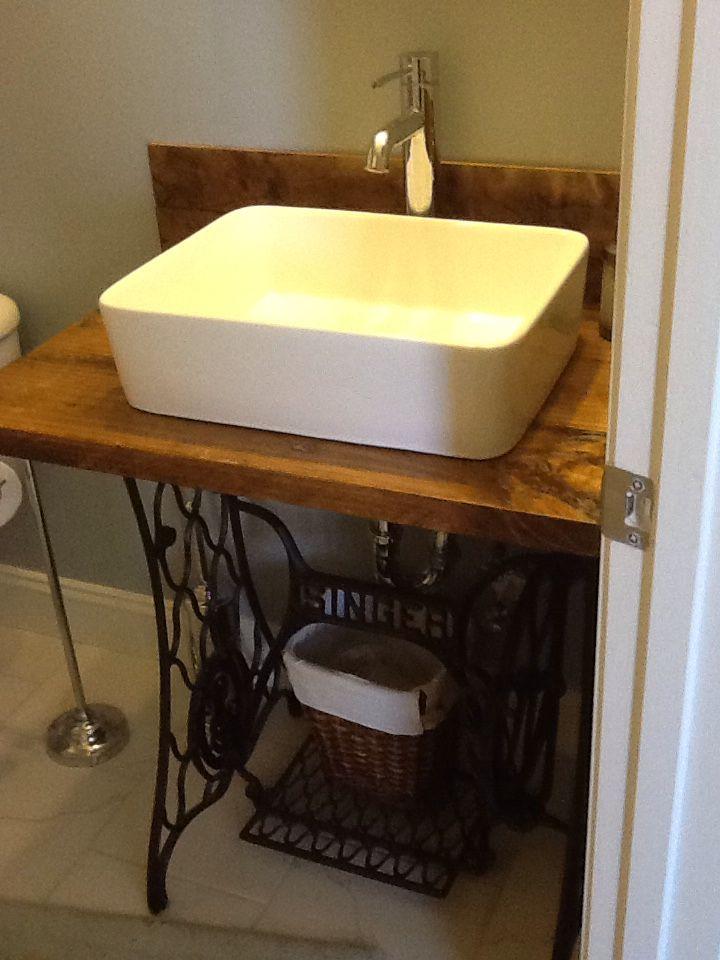 Singer sewing machine base repurposed into bathroom vanity with vessel sink