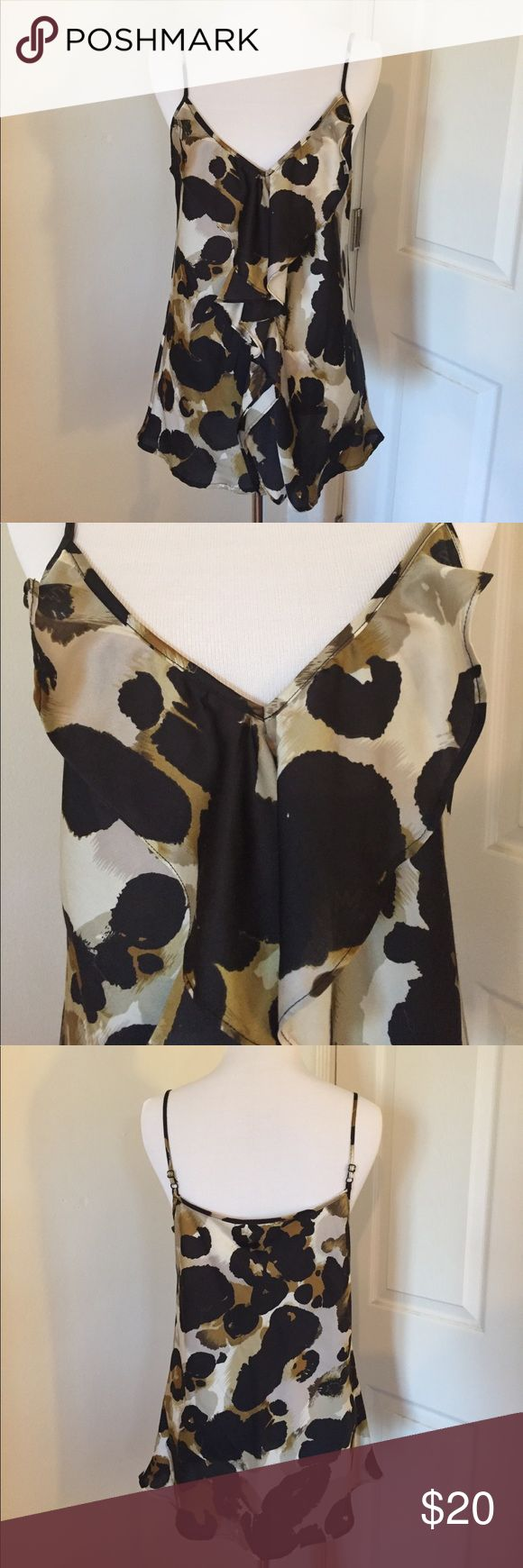 Cabi Animal Print Cami Flirty animal print cami with ruffle in front. Adjustable straps, bias cut.  Great to dress up with a suit or on its own with jeans!  100% polyester CAbi Tops Camisoles