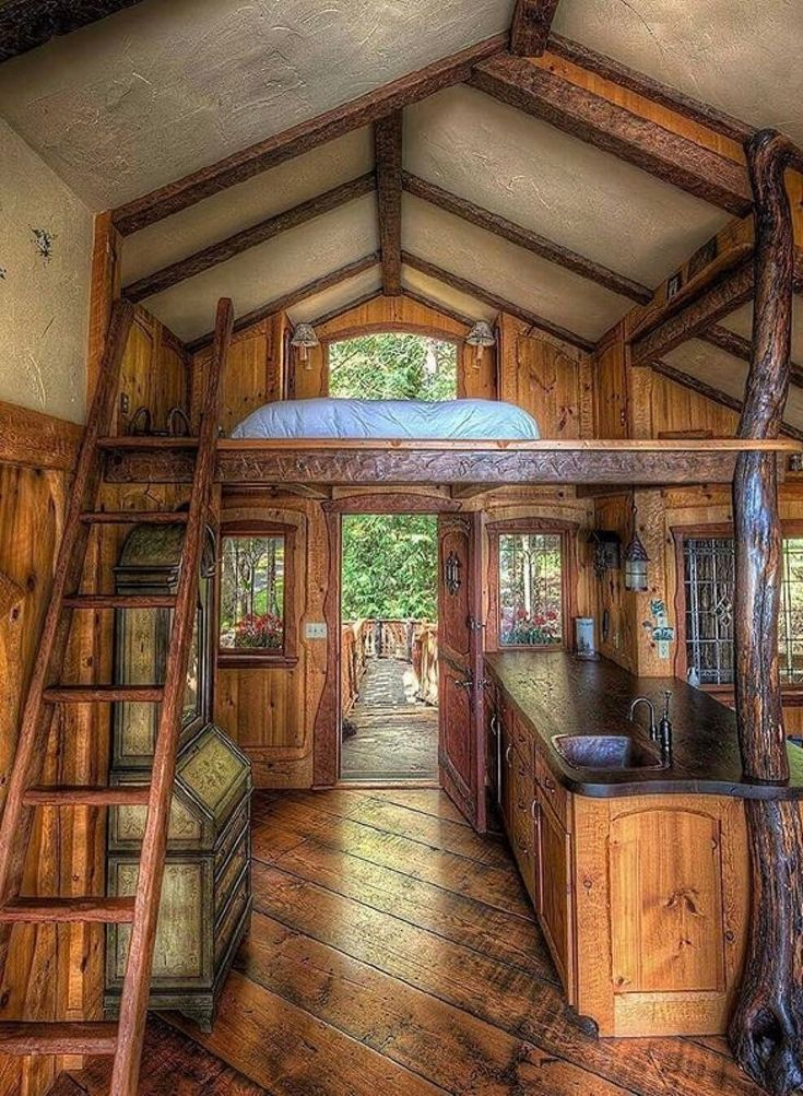 """I love the """"tree"""" in the kitchen... and the rich wood... the exposed beams... the floor..."""
