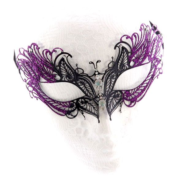 Beautiful symmetrical butterfly black metal filigree masquerade mask with purple glitter highlights and brilliant sparkle crystals down the nose and around the edges. Our filigree metal mask range are laser cut from a flexi metal that can mold to the shape of your face for that perfect fit. Height: 7.5cm approximately Width: 15.5cm approximately Mask: [...]