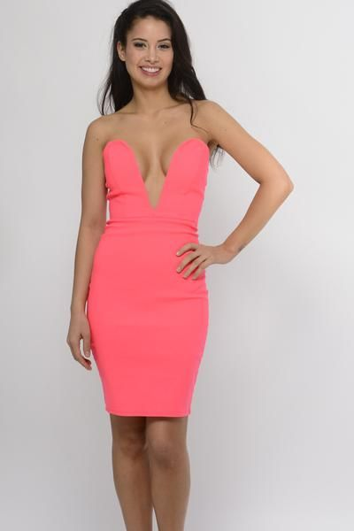Feel flirty in this low cut coral bodycon dress! Accentuate your curves in this body hugging mini dress with zip up back.  Model is wearing a Size Small 76% Rayon 21% Nylon 3% Spandex