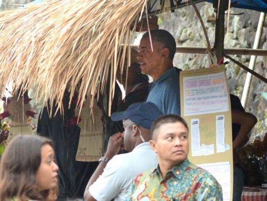 Obama Jatiluwih in shade. Mr. Obama's security team were always close to hand and nearly all were seen wearing baseball caps.