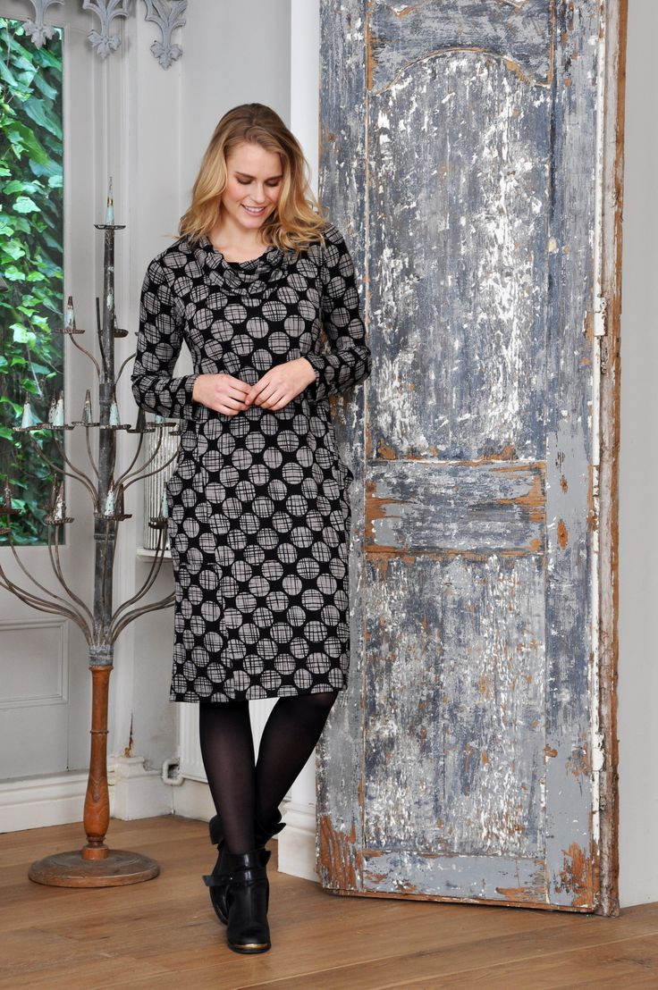 Black dress with white patterned pokka dots,  styled with black boots and tights by Capri Clothing + Inside Out.