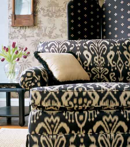 This bold Ikat sofa adds a lot of spice to this room. The diamond print screen & subtle wallpaper are perfect coordinates