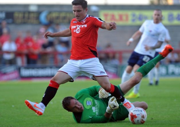 Morecambe striker Jack Redshaw has turned down a move to Peterborough United.