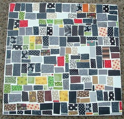 Fabric mosaic table that would look really cute as a quilt