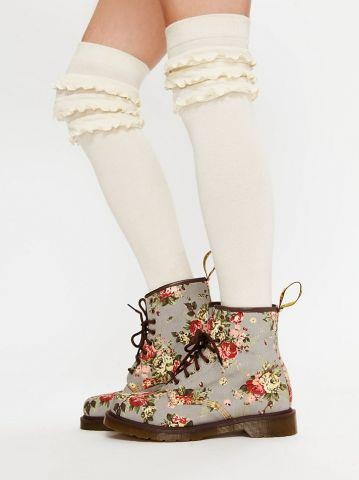 Dr. Martens Floral patterned 8 eye lace-up ankle boots. Full rubber air-cushioned soles. Weather-resistant durability and flexibility for long life. A quirky take on a punk rock classic.