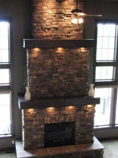 Usually antique stone used around fireplaces. Changing a simple fireplace and creating it into a statement piece within a room by adding neutral stones. Also the lighting shows the texture of the stones, against the smooth timber, and stands out.