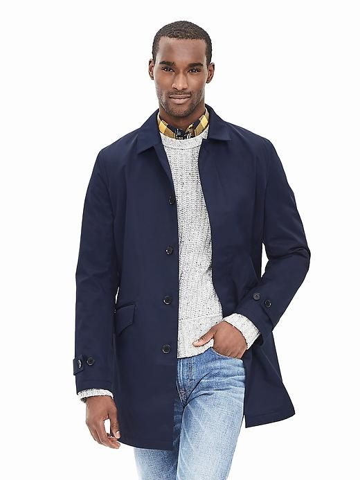 A simple, reliable trench coat is as essential to every guy's wardrobe as a sturdy umbrella (and it's a lot harder to accidentally leave behind). This one is made from bonded layers of cotton and is partially .