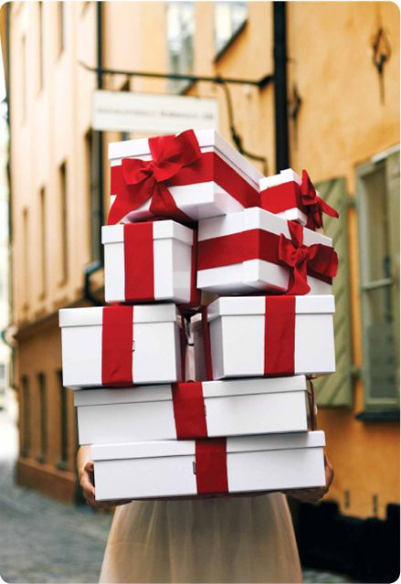 all wrapped up! white boxes and festive red ribbon present wrapping ideas