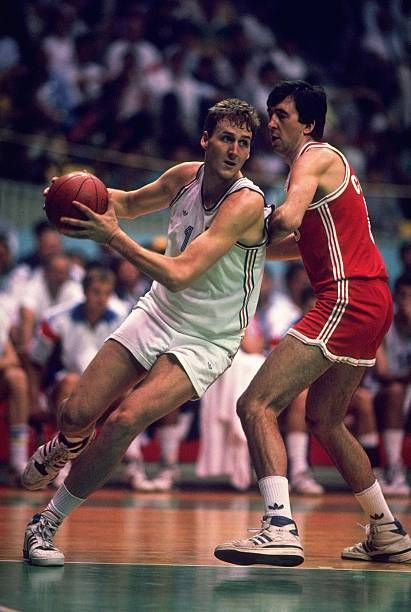 Dino Radja of Yugoslavia evades Tilt Sokk of the Soviet Union during a match in the Basketball event at the 1988 Olympic Games in Seoul South Korea...
