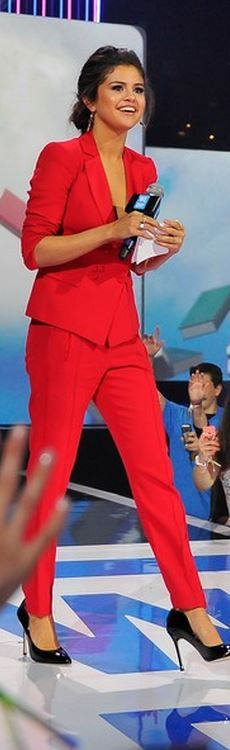 Selena Gomez, good job! Classic business suit with a twist, but will make your audience take notice. Red pants suit