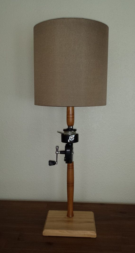 fishing pole lamp; great idea but the shade leaves you wanting...perhaps a knitted or crocheted cone shape would complete the nautical theme.