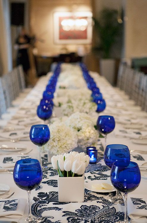 Monofloral arrangements of tulips and hydrangeas are placed in modern square vessels.