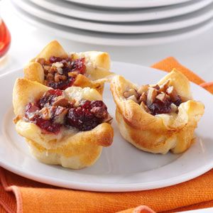 Cranberry-Brie Tartlets Recipe -My family hosts a holiday drop-in each year, and that's where these crescent tartlets made their first appearance. They're easy to make, but look like a gourmet treat. —Cindy Davis, Bonita Springs, Florida