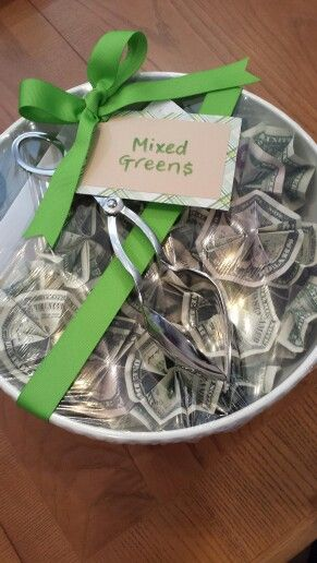 Money Housewarming Gift, fold $1, $5 and $10 bills into flowers, fill the bowl, cover with plastic wrap, wrap with a pretty bow and top with salad tongs.