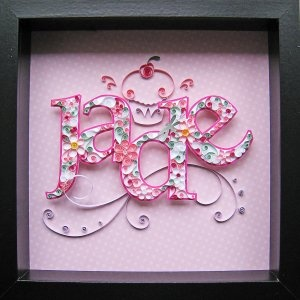 Crafting Creatures - namesake piece made of quilled paper; flowers are glued upon hand cut letter and set above a cupcake swirled background.