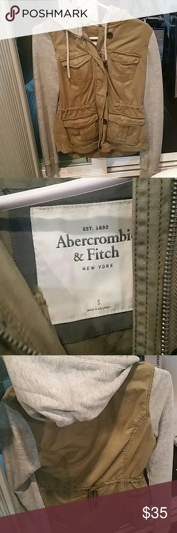 Abercrombie and Fitch jacket size S Cute two tone color jacket. Super soft fleece sleeves and hood. Cute string tie in the back to achieve a fitted  waist. Army green and grey color. Used but in like new condition. Abercrombie & Fitch Jackets & Coats Utility Jackets