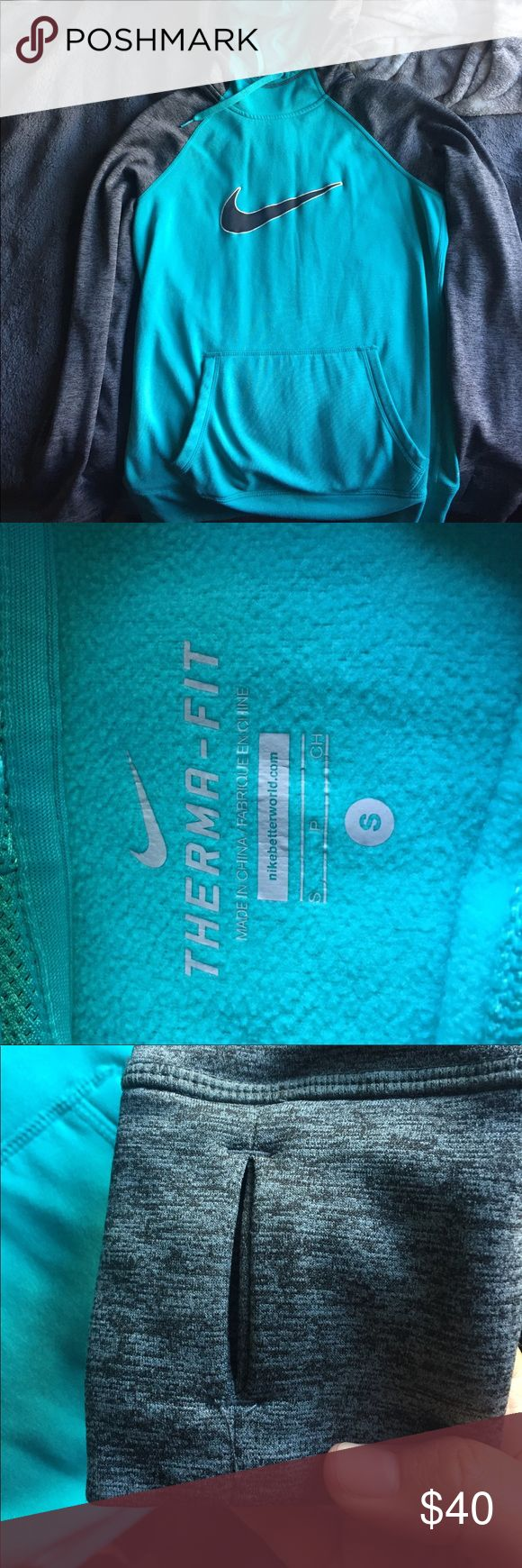 Nike Thermo Fit Hoodie Hello! I simply don't wear this enough. There are thumb holes and a big belly pocket. The inside is a soft material and the outside is more of a waterproof material. Nike Jackets & Coats