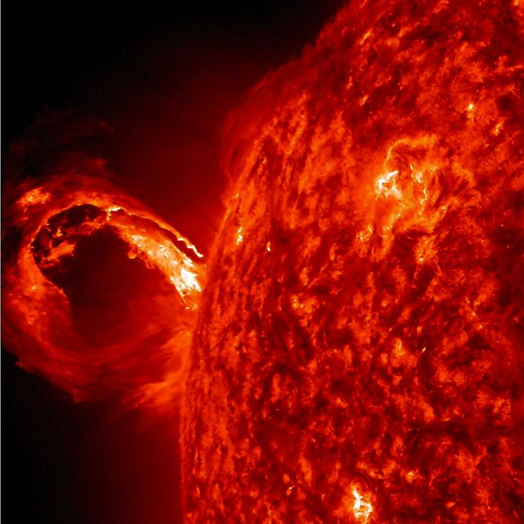 Via The Most Mind-Blowing Space Photos of 2013 - Wired Science. Enormous Solar Eruption: An explosion from the sun's surface creates a rolling wave of fiery plasma. The event shoots tons of energetic particles out into space, which in this case were safely directed away from Earth.