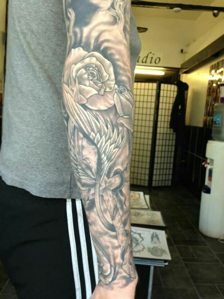 Black and grey tattoo sleeve religious