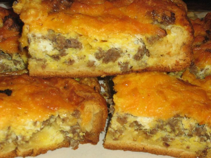 Breakfast bars. Press croissant dough in the bottom and sides of a 8x8 pan. Brown 1 lb. of breakfast sausage. Whip 5 eggs together and season with salt and pepper. Sprinkle cheese on top. Bake until the eggs are done on 350 (about 15-20 minutes). Cut and enjoy! No fork needed.: Sprinkle Cheese, Breakfast Casserole, Breakfast Bars, 8X8 Pan, Press Croissant, Fork Needed, Breakfast Sausage, Salt
