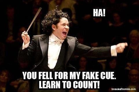 musician problems: do you follow the conductor or the score when the conductor makes a mistake???
