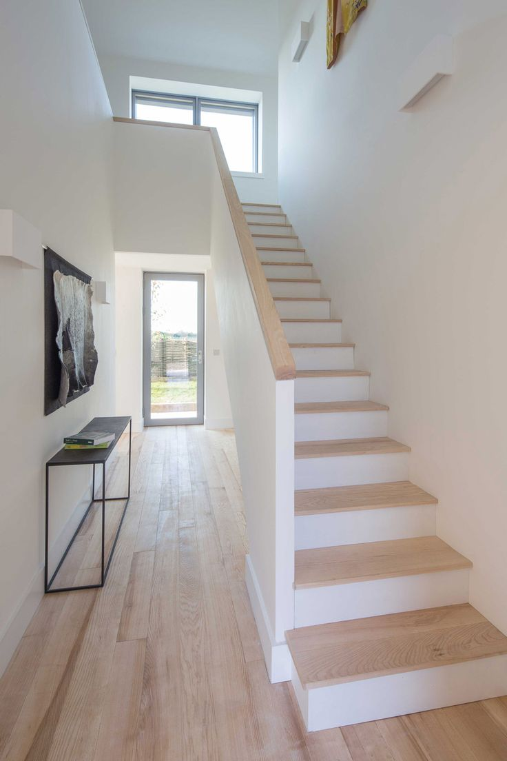 blond hardwood treads + handrail on painted softwo…