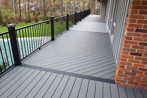 Trex Deck In Pebble Grey With Black Railing Looking For Endless Color And Style Choices Without The Maintenance Hassle Deck Designs Backyard Deck Colors Patio