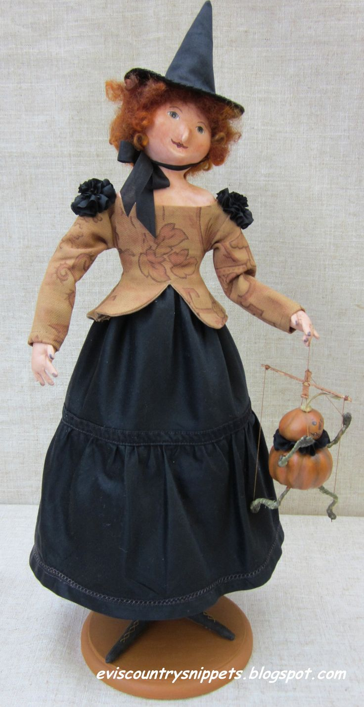 Pretty witch holding pumpkin marionette. Created by me, Evi Araujo from paper clay and antique fabric.