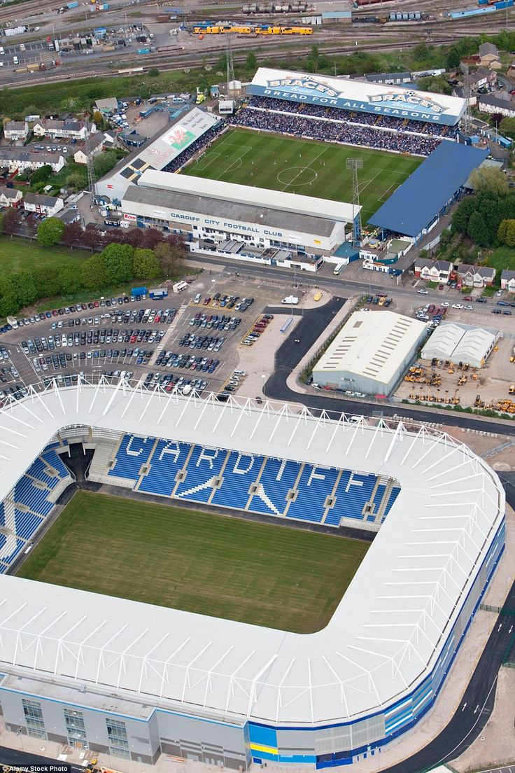 BEFORE: Cardiff's Ninian Park stadium (top) was just a few hundred yards from where the new Cardiff City stadium now stands (bottom)