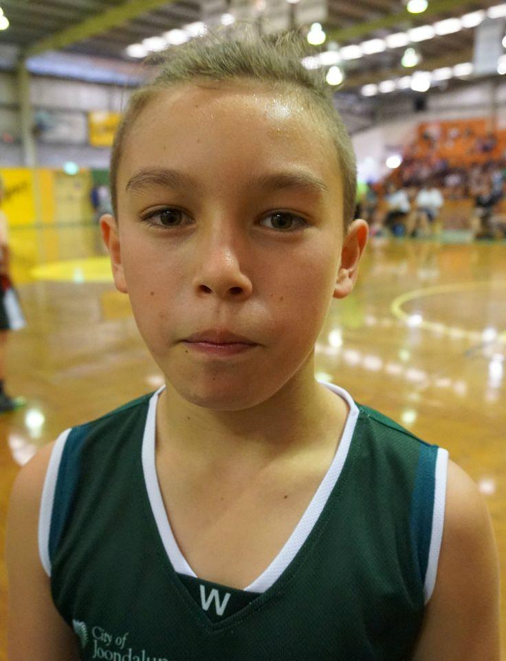 L1M1AP1 Portrait Grandson Jae at basketball. f/4.5 1/50 ISO3200