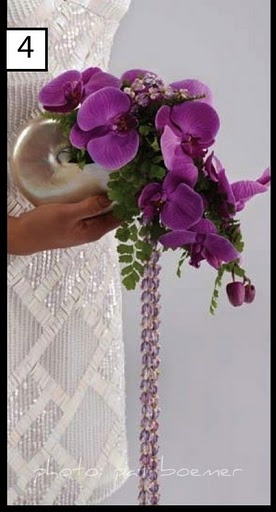 Pendulum bouquet from Rene's Bouquets orchid/crown flower lei/nautilus shell