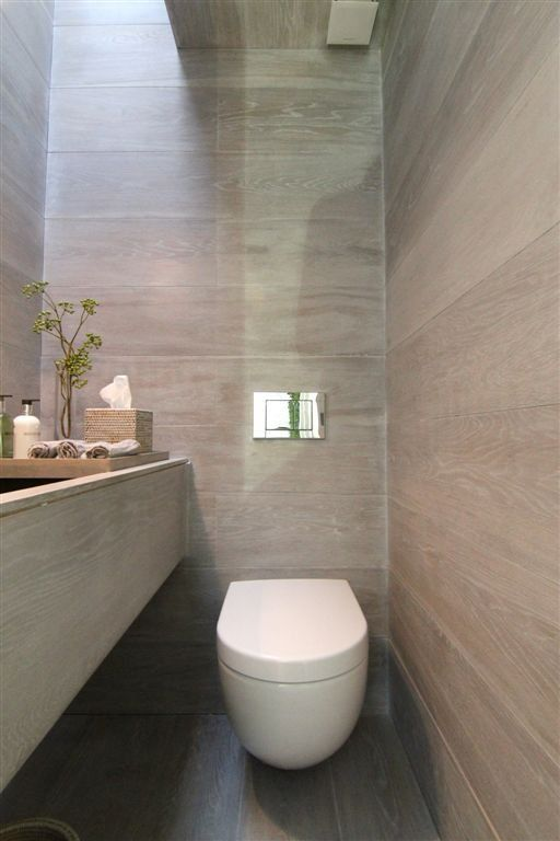 | BATHROOMS | Photo Credit: Knightsbridge Renovation by #RajivSaini&Associates. Floor to ceiling finishes oversized sink and integrated countertop trays