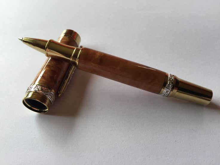 This pen has been hand turned from one piece of Myrtle that has been sanded and sealed to a finish that feels as smooth as glass.   Plating is Gold Titanium with Rhodium Accents.   The photographed item is the item that you will receive. Case included.  Shipping: If the item costs less to ship than