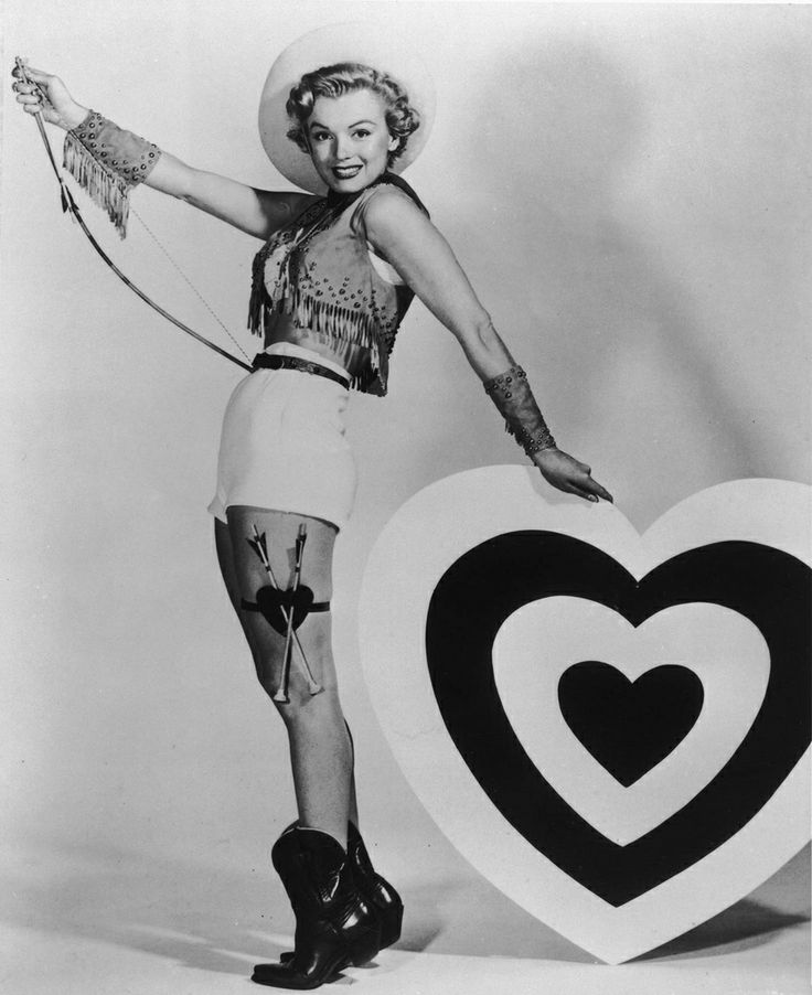 Image result for vintage photo of  a woman holding a valentine's day heart of chocolates