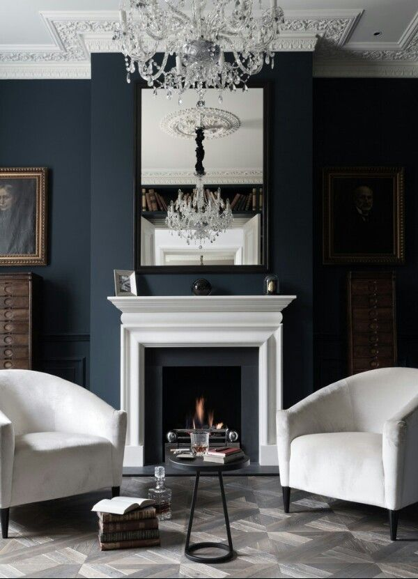 Couch beside a fire place...love the idea...with a blue wall...interesting