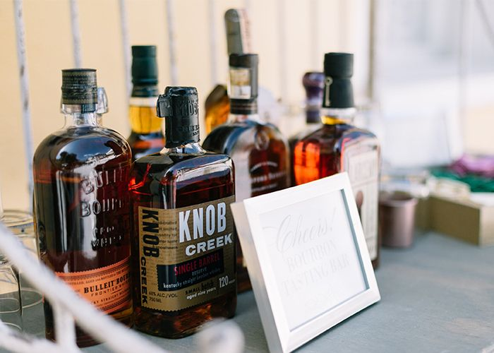Bourbon Bars offer a perfect Southern welcome for wedding guests at The William Aiken House | Fall Wedding Inspiration | Charleston, South Carolina | Photo by Catherine Ann