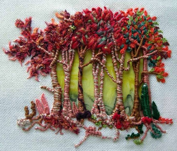 These lovely Autumn trees were embroidered by a student of Francine Leclercq. Francine is a noted textile and embroidery artist.  Check out more of Francine's - and her student's - work at http://www.aufilduleman.fr/broderie