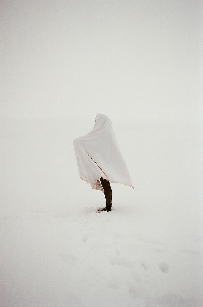 J. Kursel  Loved this image.  It's so simple but it's meaning could be interpreted in so many ways.  I love that the model is in the snow with a white blanket and the only contrast you see is her black leggings. It's very playful.
