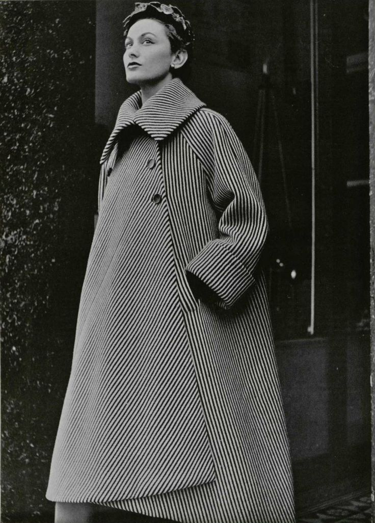 This coat was designed by Cristobal Balenciaga in the 1950s. He became a major influencer after WWII and was considered a master craftsman and innovator.