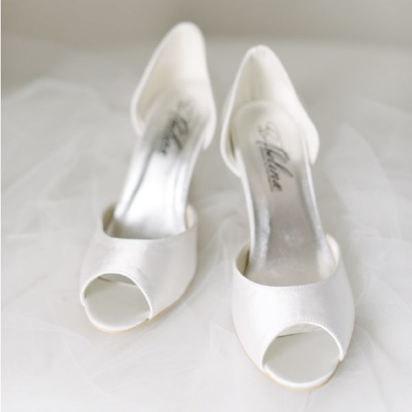 Satin Peeptoe Wedding Shoes by Pearl & Ivory ®  - Find more elegant wedding shoes from our collection www.pearlandivory.com/bridal-shoes.html. Photography by Yolande Marx #PearlandIvory #WeddingShoes #SatinHeels #Peeptoe #BridalShoes