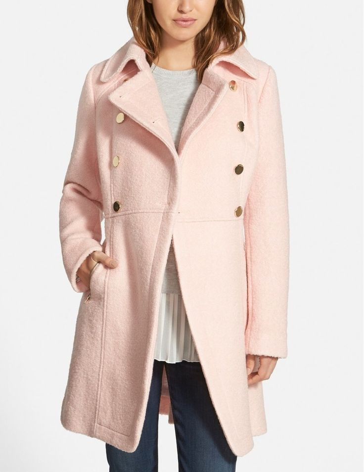 A broad notch collar and double-breasted styling with shiny regimental buttons bring classic military polish to this cozy pink coat. Zip pockets and cuffs add a modern edge, while topstitched detailing accentuates the flattering cut.