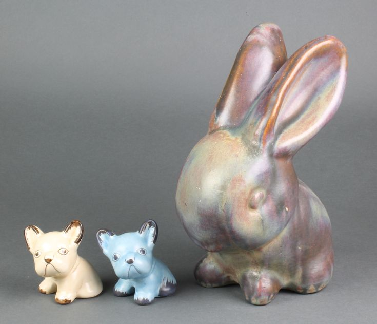 """Lot 3, A Denby Ware Bourne slip glazed figure of a seated bunny 11"""", 2 Art Deco figures of dogs 3"""", sold for £85"""