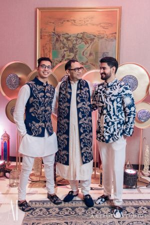 Family members co-ordinated in matching bridal menswear | WedMeGood | #wedmegood #indianweddings #blue #sherwani #jacket #white #groomswear #menswear #halfjacket #nehrujacket