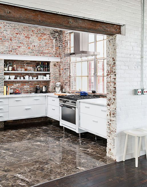 Another repurposed factory building, this 19th-century site in New York was transformed into a modern live/work space. Original brick adds texture, especially when contrasted with the new, marbledfloor tile.  Photo by Ball & Albanese.