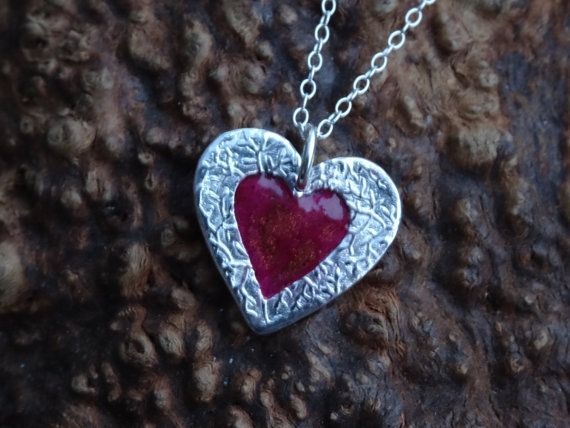 A gorgeous heart pendant handmade in fine silver, (99.9%).The centre is filled with a resin containing mica powder in different shades of red and a hint of copper. Fantasti... #trending #etsy #hmuk #styl